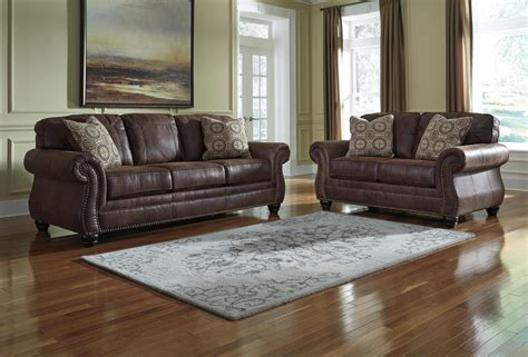 benchcraft leather sofa benchcraft breville faux leather sofa with rolled arms and
