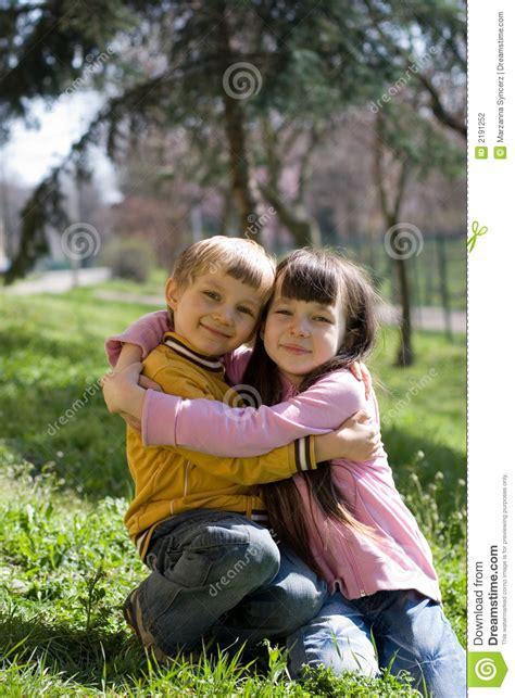 children hugging stock photography image