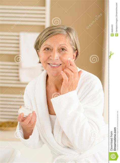 bathroom facial senior woman with facial cream in bathroom stock image image 26284451