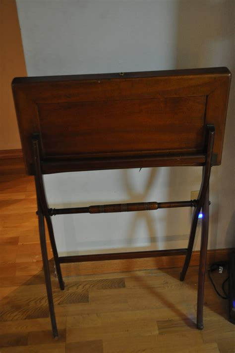 i an antique folding writing desk