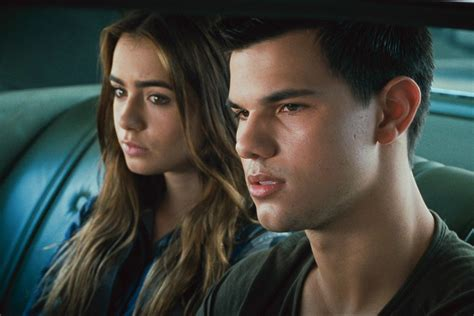 abduction l lautner holds collins tight photos celebuzz