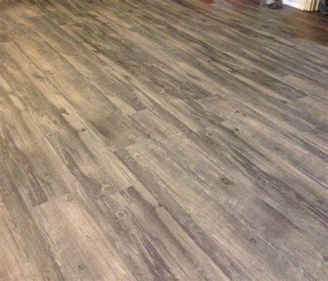 vinyl plank flooring and trim quarter round installed