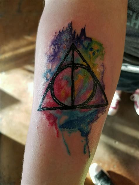 tattoo des moines deathly hallows done by nate at sacred