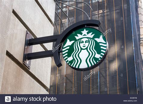 coffee shop in new york starbucks sign with company icon outside a coffee shop in