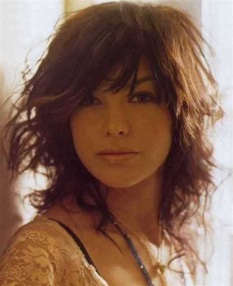 Curly Hairstyles With Bangs And Layers by Layered Medium Curly Haircut With Side Bangs