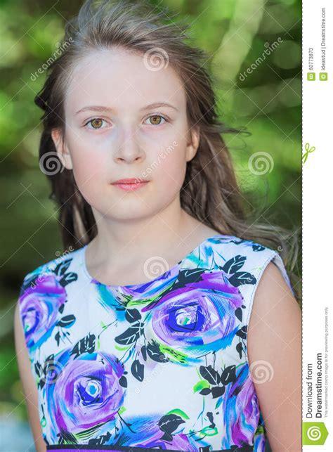 cute preteen cute preteen long hair girl posing on natural green