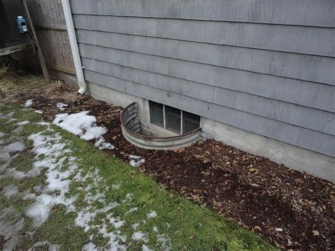 a view of an outside basement window from a home in