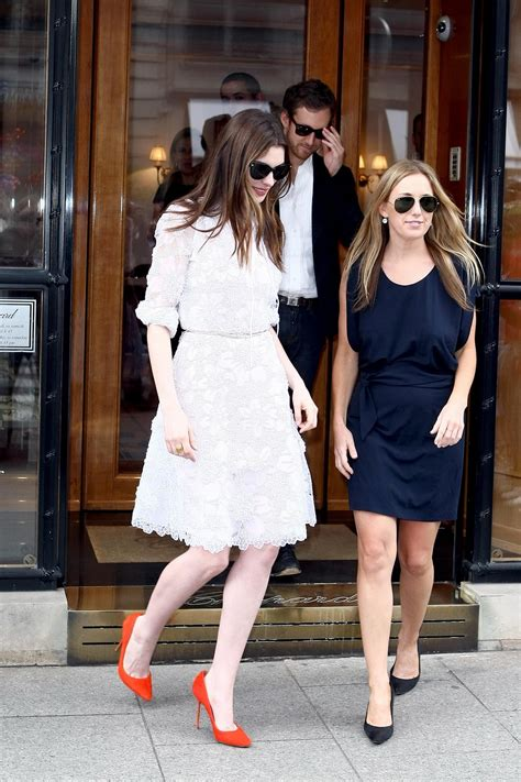 anne hathaway in white dress attending to a givenchy