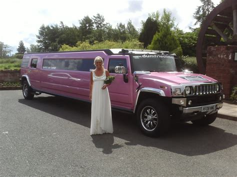 Pink Hummer Limo by Pink Hummer Limo Excalibur Wedding Cars
