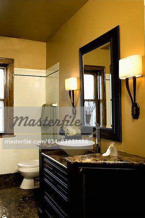 bathroom bright mustard colored walls  black