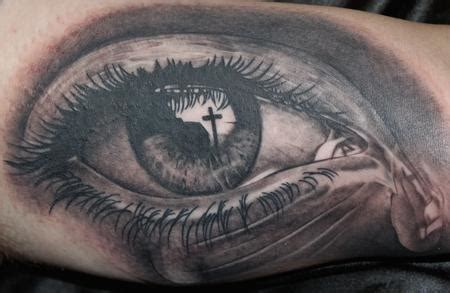 tattoo cross eye full color space and eyeball half sleeve tattoo by evan