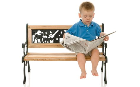 kids reading bench give a kid a newspaper and he will read for a lifetime