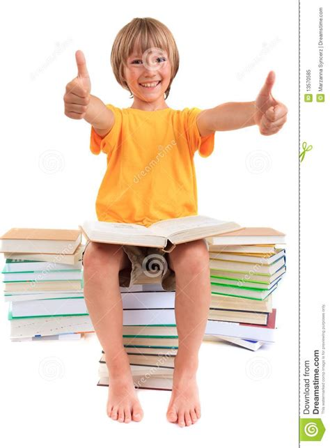 thumbs up my brown boy books boy sitting on piles of books royalty free stock photo