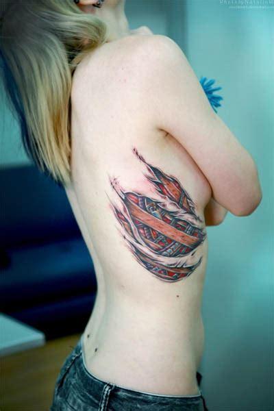 torn ripped skin tattoo on biomechanical torn flesh ribcage tattoo tattoo design