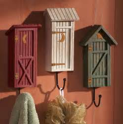 Wooden country outhouse metal wall hook trio
