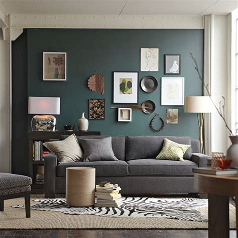 teal colored accent wall in living room with grey neutral accents paint color