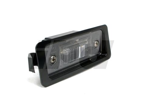 license plate light assembly  genuine volvo
