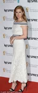 Dress which featured nipped in her tiny waist thanks to a sports trim