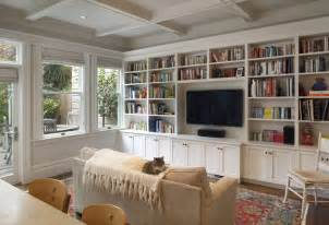 houzz built in bookshelves houzz family room family room rustic with exposed beams ceiling lighting