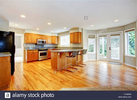 large kitchen family room large empty open kitchen with living room with balcony doors and stock photo royalty free image