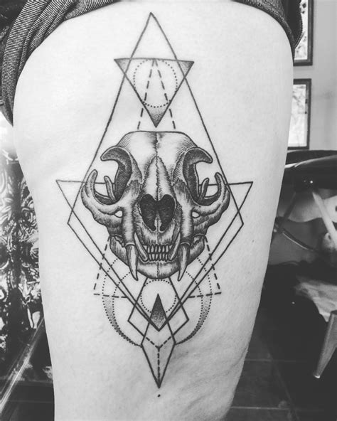 cat skeleton tattoo geometric cat skull blackwork dotwork thigh