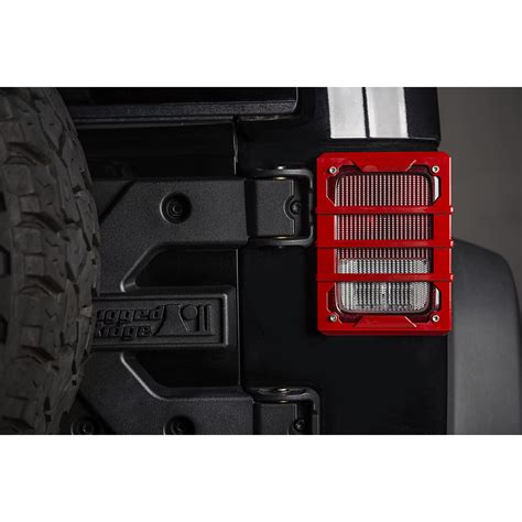 jeep tail light guard rugged ridge 11226 06 elite tail light guards red 07 17