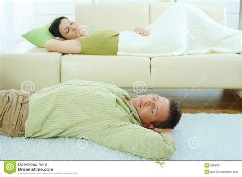 i sleep on a couch couple sleeping on couch stock image image 9688761