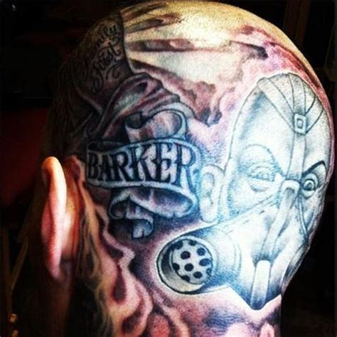 travis barker head tattoo former blink 182 drummer got his new band logo tattooed on