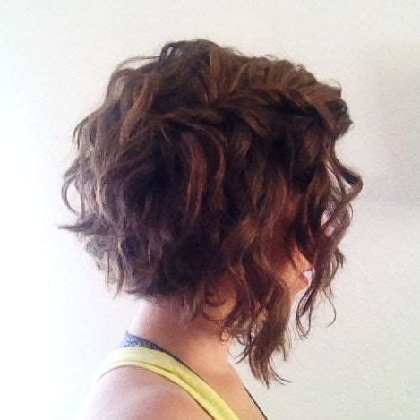 angled cut outward curl hairstyles curly wavy angled and graduated long bob hairstyle with
