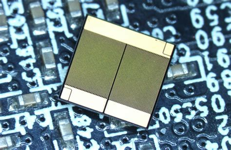 solid state integrated circuit demonstrated in charged evs monolithically integrated gan half bridge enables smaller more powerful voltage