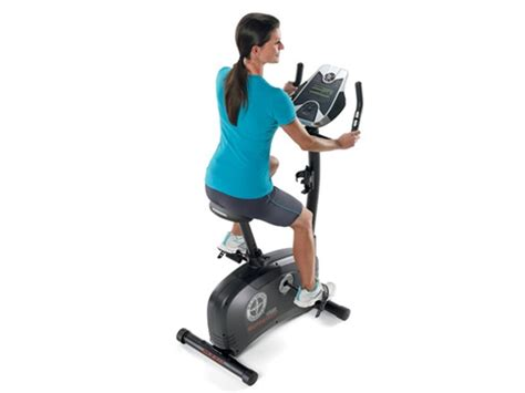 reclining exercise bike vs upright schwinn exercise bike recumbent upright