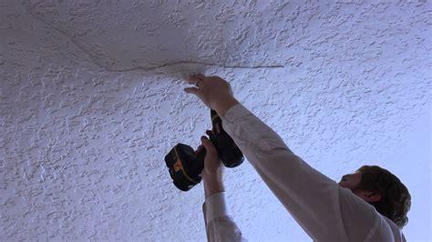Calcimine Ceiling Repair - ceiling plaster repair on a small buckling