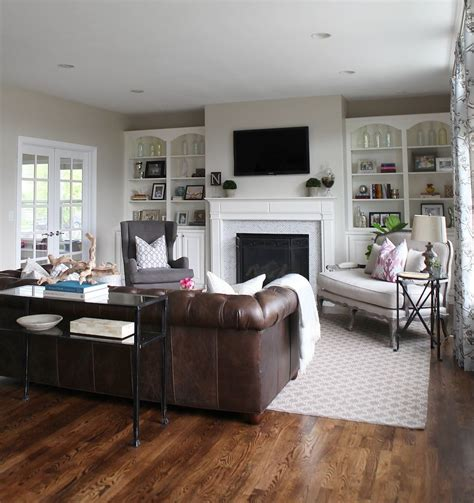 grey walls brown sofa a light airy and family friendly living room living