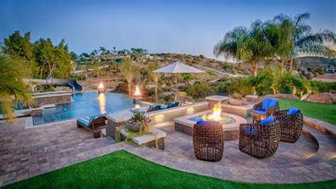 tropical pool deck  stone fire pit unique wicker