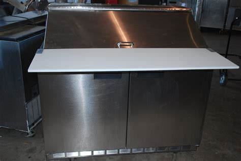 variety of used refrigerated prep tables all up in this