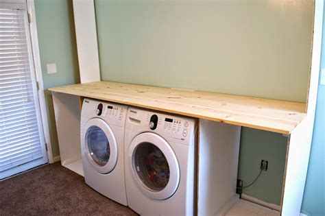 Remodelaholic Built In Laundry Unit With Shelving How To Build A Laundry