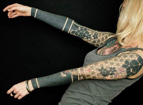 patterned geometric full sleeve tattoo by gerhard wiesbeck