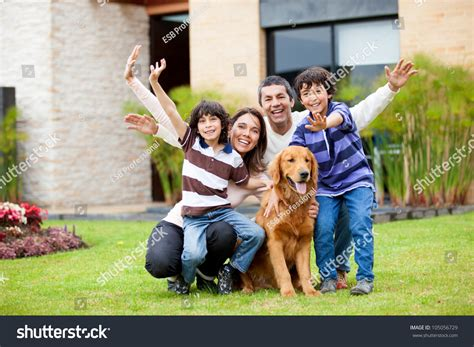 happy dog house happy family dog outside their house stock photo 105056729 shutterstock