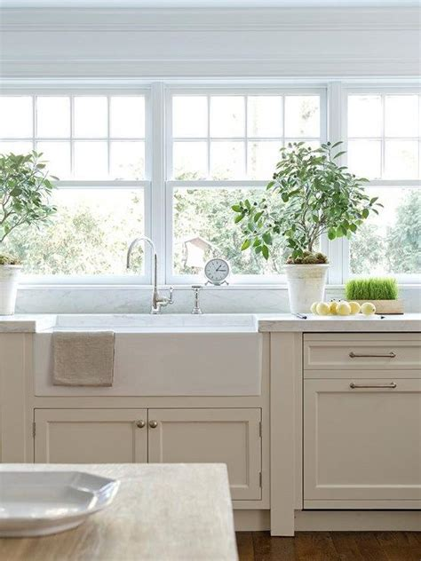 tan kitchen cabinets tan kitchen cabinets with white marble countertop