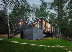 modern prefab cabin in uses innovative wood panels