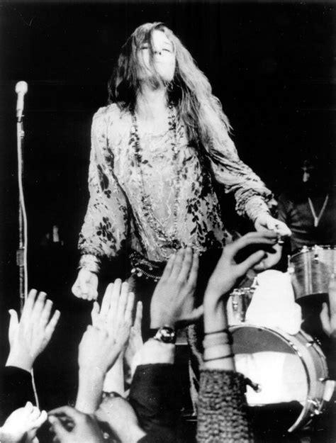 janis joplin onstage hair flowing  hands waving photo