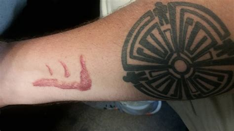 the mark of cain tattoo fan finally got a of cain placement is