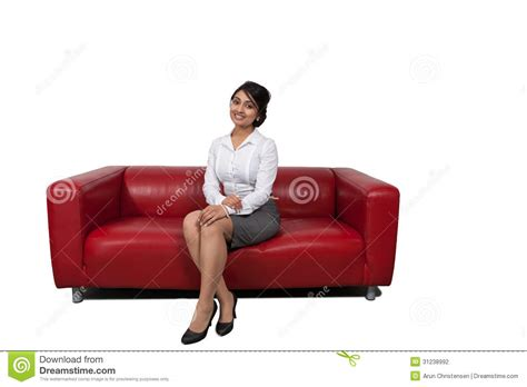 sitting on sofa businesswoman sitting on a sofa stock photography image