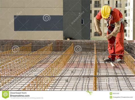 worker installs rebar horizontal stock photo image