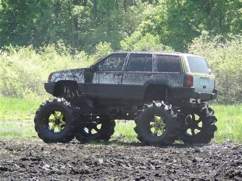 mud jeep cherokee battle of the 1979 ford bronco vs jeep grand cherokee at