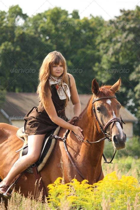 commercial girl riding horse beautiful teenager girl riding horse at the field of