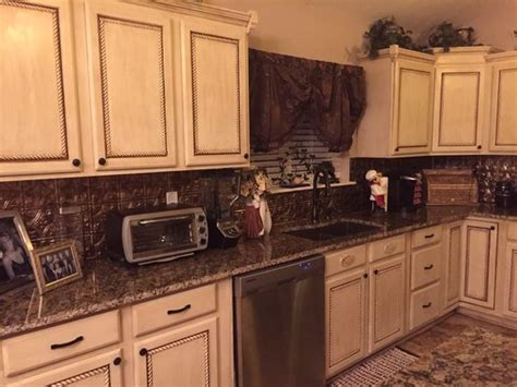 we used rope trim on the cabinet doors back splash panels