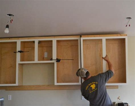 how do you hang kitchen wall cabinets installing kitchen cabinets momplex vanilla kitchen ana white woodworking projects