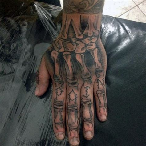 bone tattoo on finger 33 attractive finger tattoos for men