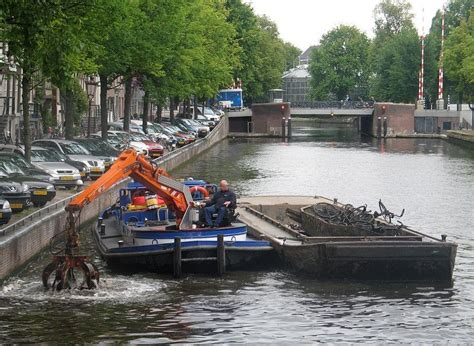 trash boat amsterdam fishing for bicycles in amsterdam s canals amusing planet